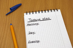 Todays plan. Words Todays plan, Morning, day and Evening written on white note pad with ballpoint pen royalty free stock image