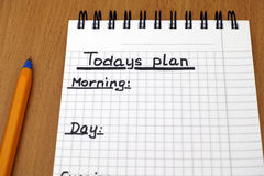 Todays plan. Words Todays plan, Morning, day and Evening written on white note pad with ballpoint pen royalty free stock images