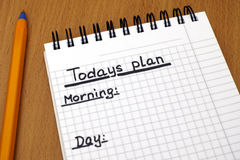 Todays plan. Words Todays plan, Morning, day and Evening written on white note pad with ballpoint pen royalty free stock photography