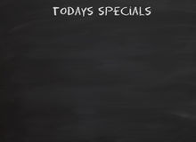 Todays specials on blackboard Royalty Free Stock Photos