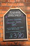 Todays specials board. Todays Specials chalkboard against a brick wall advertising Pulled Pork Bap stock images