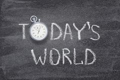 Todays world watch. Todays world phrase written on chalkboard with vintage stopwatch used instead of O royalty free stock photos