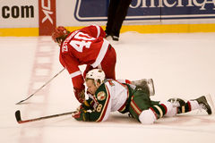 Todd White And Henrik Zetterberg Collide. Todd White of the Minnesota Wild collides with Henrik Zetterberg during a game against the Detroit Red Wings at Joe stock images