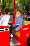 Todder in red car in amusement park Stock Photography