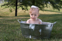 Todder in Tub. Image of cute toddler sitting in a tub outside Stock Images