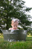 Todder in Tub. Image of cute toddler sitting in a tub outside Royalty Free Stock Photography