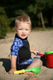 Toddle at beach. Toddler playing with shovel and bucket at beach Royalty Free Stock Photography