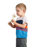 Toddle boy holding giant Dandelion. isolated on white. Blond boy holding giant Dandelion. isolated on white Stock Photos