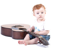 Toddle with guitar. A toddler plays with a guitar Stock Photography