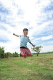 Toddle jump at field stock image