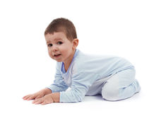 Toddle in pajamas. All fours, isolated on white Royalty Free Stock Photo