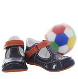 Toddle shoes. Leather toddle shoes and a soccer ball on white background Stock Photo