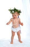 Toddler. Girl in white diaper cover, with string of pearls, on white background Royalty Free Stock Photos