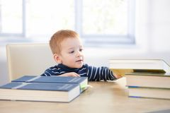 Toddler acting like schoolboy Royalty Free Stock Photography