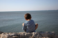 Toddler admiring the sea Stock Photography