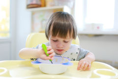 Toddler age 2 years eats oatmeal Royalty Free Stock Image