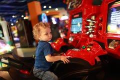 Toddler on amusement bike Royalty Free Stock Photo