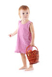 Toddler with apples in basket Stock Image