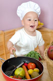 Toddler as an chef Stock Images