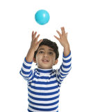 Toddler attempting to catch a Ball Royalty Free Stock Photography