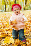 Toddler in autumn park royalty free stock photos