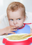 Toddler baby boy eats Royalty Free Stock Photo