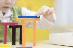 A little girl builds a house from the designer stock images