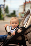 Toddler in baby carriage Royalty Free Stock Images