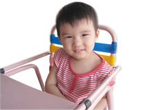 Toddler on Baby Chair. Toddler on metal Baby Chair Royalty Free Stock Photo