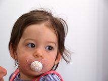 Toddler baby girl using a pacifier dummy Stock Photography