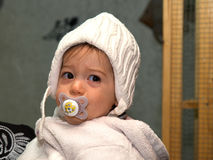 Toddler baby girl using a pacifier dummy Stock Photo
