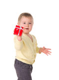 Toddler baby holding box with gift Stock Images