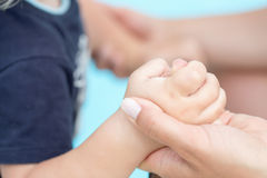 Toddler baby holding his mothers finger, selective focus. Toddler baby holding his mothers finger. Selective focus Royalty Free Stock Photos
