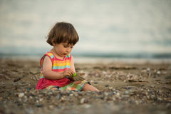 Toddler baby playing on a beach Royalty Free Stock Images