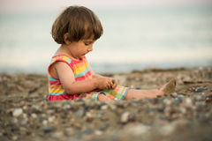 Toddler baby playing on a beach Stock Photography