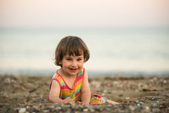 Toddler baby playing on a beach Royalty Free Stock Image