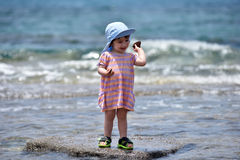 Toddler baby playing and having fun in sea water Stock Photo