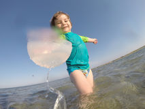 Toddler baby playing in shallow sea water Royalty Free Stock Photo