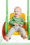 Toddler baby playing on the swings Royalty Free Stock Photos