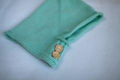 Toddler baby pulls socks, independence, childhood, home, light Stock Images