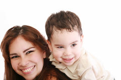 Toddler on back of his mother Royalty Free Stock Images