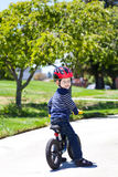 Toddler on a balance bike Royalty Free Stock Image