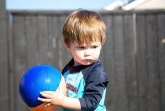 Toddler and a ball Royalty Free Stock Photos