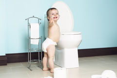 Toddler in bathroom look at the toilet Stock Photos
