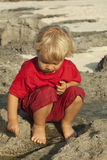 Toddler at the beach. 2 years old toddler playing by on the beach Royalty Free Stock Photography