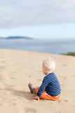 Toddler on the beach Stock Images