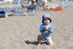 Toddler on beach Stock Photo