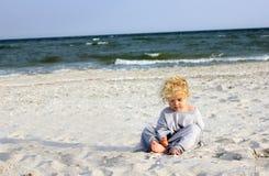 Toddler on the beach Stock Photo