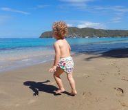 A toddler on a beach in the caribbean Royalty Free Stock Photo