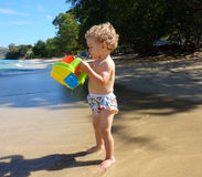 A toddler on a beach in the caribbean Royalty Free Stock Images